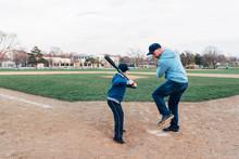 Dad Showing Baseball Bat Swing...