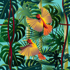Panel Szklany Egzotyczne Flying hummingbirds in the thickets of a flowering rainforest.