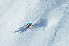 Man Skiing Down The Slope