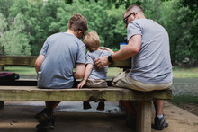 Father And Two Sons Eat Togeth...