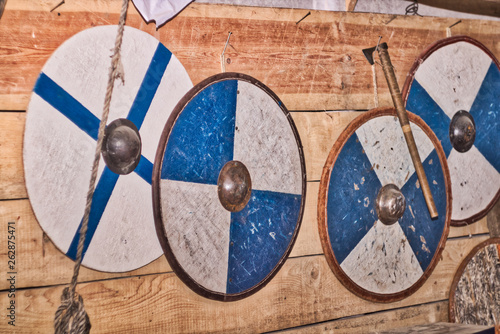 Blue round blye shitry Vikings hang on the wooden wall Wallpaper Mural