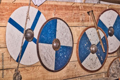 Vászonkép Blue round blye shitry Vikings hang on the wooden wall