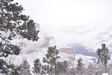 Grand Canyon, AZ., U.S.A. Dec. 31, 2018.  Grand Canyon National Park New Year's Eve Afternoon With Light Snow Falling.