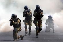 Special Force Assault Team Under Smoke Screen Background