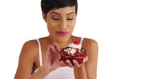 Close Up Of Black Female Eatin...