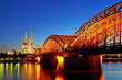 Beautiful night with hohenzollern bridge and cathedral in Cologne, Germany