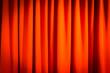Leinwanddruck Bild - Red closed curtain with a light spot