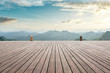 Empty wooden planks platform and mountain with clouds landscape