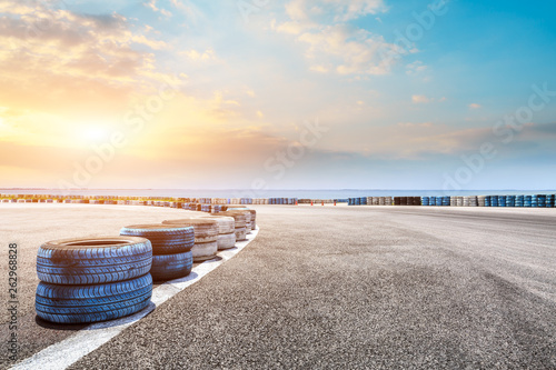 Recess Fitting F1 Asphalt race track ground and river with beautiful clouds at sunset