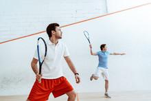 Two Sportsmen Playing Squash W...