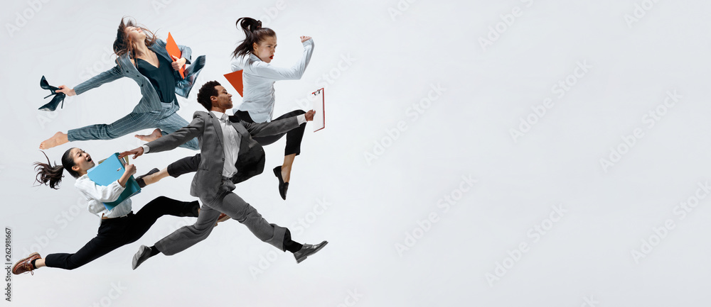Fototapety, obrazy: Happy business women and african man dancing isolated on white.
