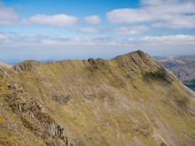 Striding Edge In The North West Lake District In Cumbria, England, UK: A Popular Route Linking The Summit Ridge Of Birkhouse Moor To Helvellyn's Summit By What Becomes A Sharp Arête