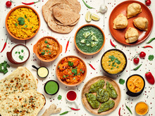 Indian Cuisine Dishes: Tikka Masala, Dal, Paneer, Samosa, Chapati, Chutney, Spices. Indian Food On White Wooden Background. Assortment Indian Meal Top View Or Flat Lay.