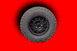 Leinwanddruck Bild - Car wheels on a white background behind a cutting machine separately,Tires