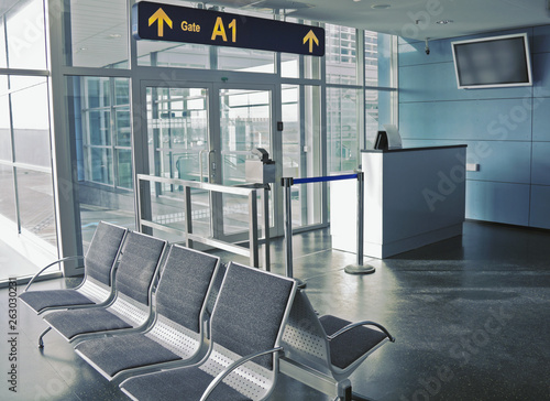 Foto op Aluminium Luchthaven Closed boarding gate with empty seating in airport, real indoor departure terminal picture with no people