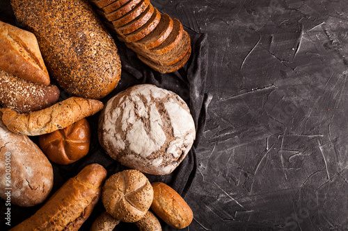 Assortment of baked goods on dark background Canvas Print