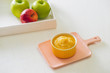 Homemade healthy baby food. Bowl of apple baby puree.