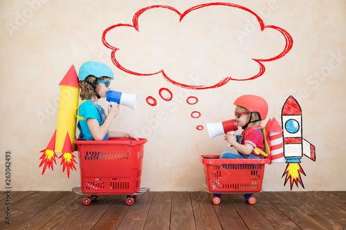 Fotografie, Obraz  Happy children driving toy car at home
