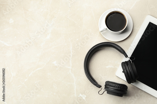 Fototapeta Flat lay composition with headphones, tablet and cup of coffee on table. Space for text obraz na płótnie