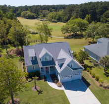 Low Aerial View Of House With ...