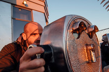A Man Looking With Binocular In New York