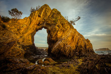 A Natural Arch In Bateman's Bay, On The Rugged Coast Of Australia