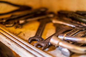 Old tools on a wood shelf isolated