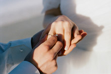 Groom Putting On A Ring  On Th...