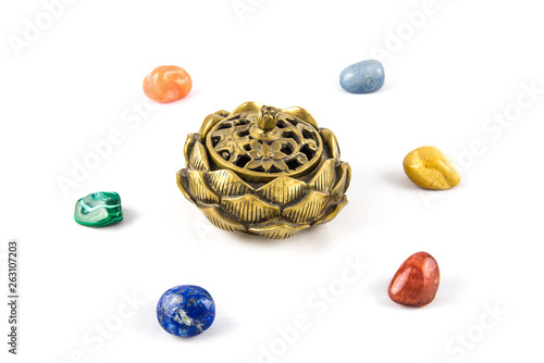 Fototapeta Colored stones in a circle around a lotus shaped censer