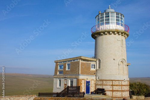 Fotografie, Obraz  Lighthouse on white cliffs of Seven Sisters, United Kingdom.