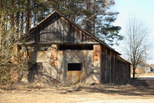 Rural Landscape - Abandoned Large Hangar On The Edge Of The Village On A Sunny Spring Day