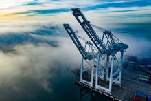 Port Cranes In Morning Fog Aerial Photo With Space