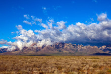 Arizona's Chiricahua Mountains Under A Large Storm Cloud