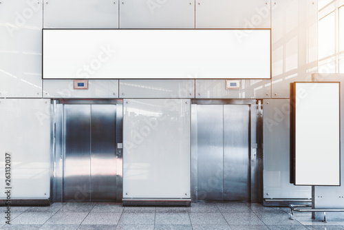 Fotografie, Obraz  Two modern elevators in an airport terminal or a shopping mall or a railway stat