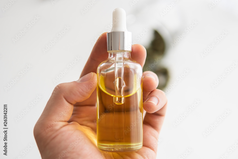 Fototapety, obrazy: medical marijuana concept, close up, CBD cannabis OIL. hemp product, bottle of Cannabis oil in pipette in hand,