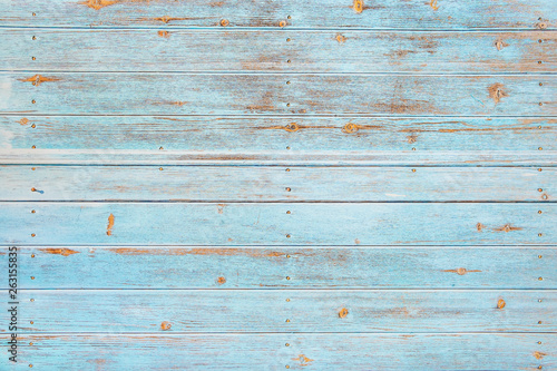 Vintage beach wood background - Old weathered wooden plank painted in turquoise or blue sea color. - 263155835