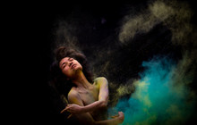 Model Asian Girl Emotion Posing And Movement With Dust Color On Dark Background
