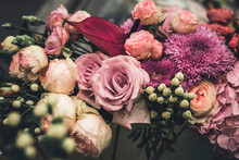 Flower Arrangement Of Different Colors. The Photo Is Processed In Vintage Style, Toning And Light Blur.