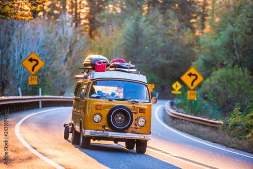 Recess Fitting Vintage cars Old mini van for tourist travels rushing along sunny winding road