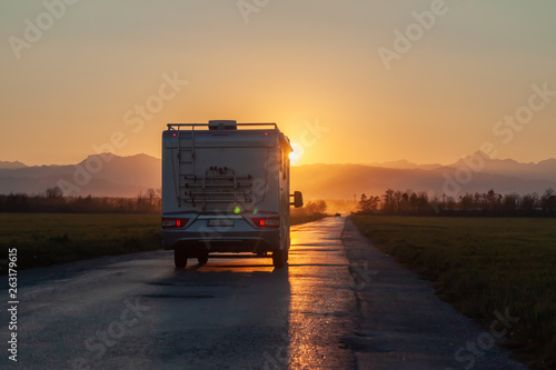 campervan on the road heading to sunset Fototapet