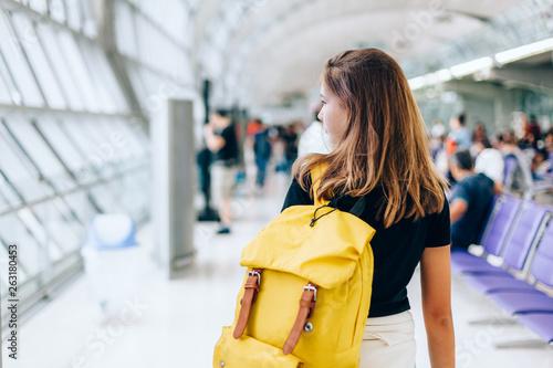 Teen girl waiting for international flight in airport departure terminal Fototapeta