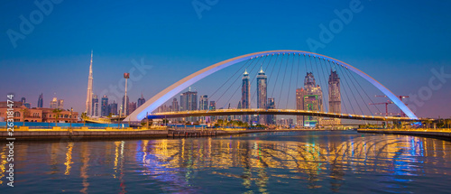 Dubai city skyline at night. view of Tolerance bridge