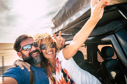 Fotografie, Tablou  Happy couple cheerful and smile in selfie picture style together hugging with re