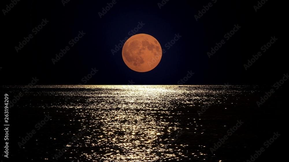 Fototapeta Full moon light reflect in sea water, summer romantic night at seaside
