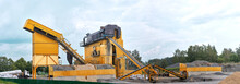 Mobile Concrete Batching Plant. Equipment For Production Of Asphalt, Cement And Concrete For Road Works. Cement Production Factory On Mining. Conveyor Belt Of Heavy Machinery Loads Stones And Gravel
