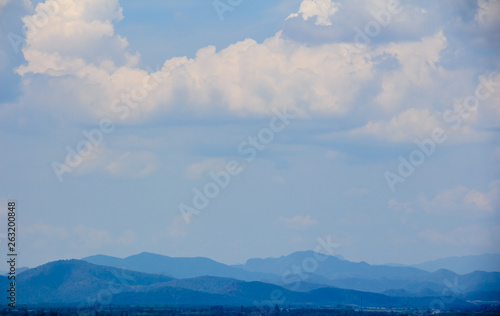 Canvas Prints Light pink landscape with mountains and clouds, blue tone.