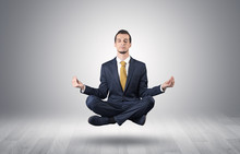 Businessman Levitates And Sitting In Yoga Position In An Empty Infinity Space