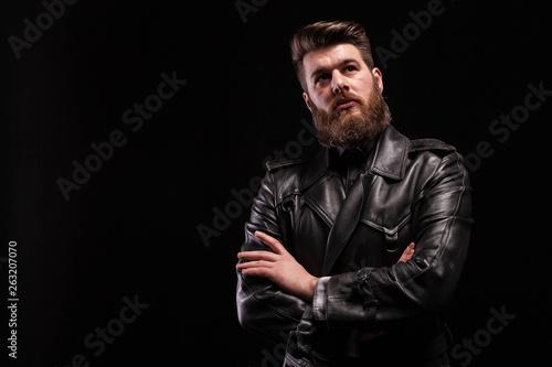 Fototapeta Attractive bearded man keeping his arms crossed over blac background obraz na płótnie