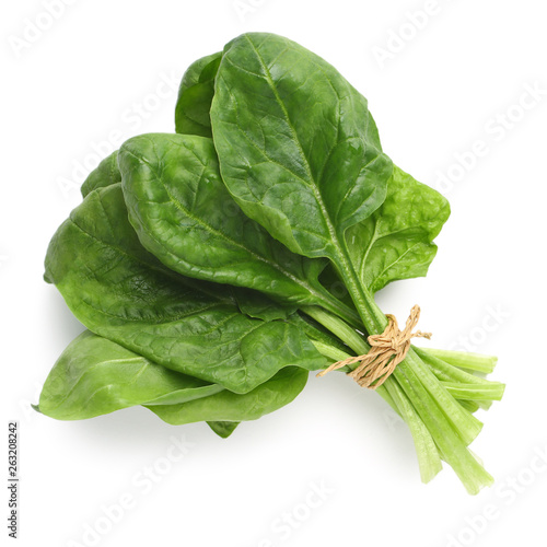 Photo Bundle of fresh spinach isolated on white, top view