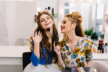 Two Amazing Joyful Models Having Fun Together In  Haidresser Salon. Preparing To Party, Expressing True Positive Emotions, Laughing, Smiling, Coiffure, Makeup, Professional Beauty